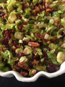 SHAVED BRUSSELS SPROUTS WITH ONIONS, CRANBERRIES & BACON